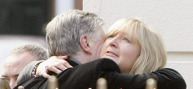 Pat Kenny (left) hugs Siobhan Hock outside Gerry Ryan's family home in the north Dublin suburb of Clontarf .
