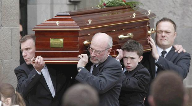 Gerry Ryan's coffin is carried from St John the Baptist Church in Clontarf, Dublin, by his brother Mick (left) and his son Elliot (second right), following his funeral service