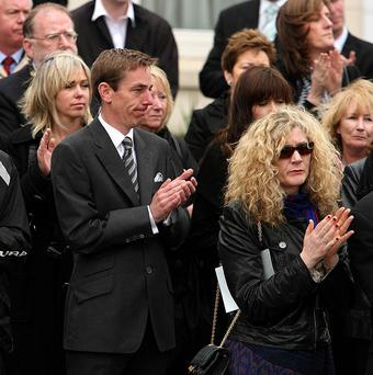Presenter Ryan Tubridy (centre) among mourners at the funeral of broadcaster Gerry Ryan