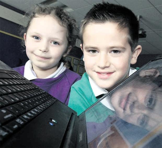 Pupils Adam McAleenan and Katie Osborne give the new online idea their the seal of approval