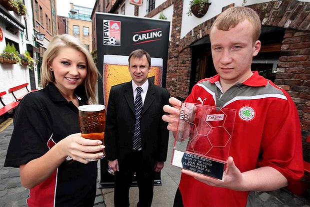 Cliftonville striker Liam Boyce receives the Carling Player of the Month award for April from Carling's Brian Brannigan and Catherine Milligan