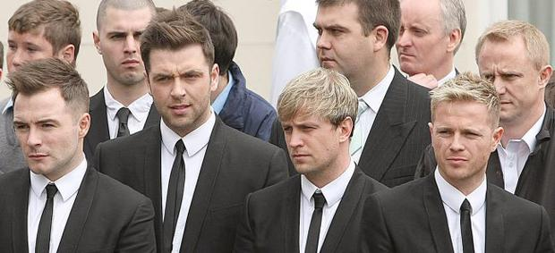 Members of Westlife (left to right) Shane Filan, Mark Feehily, Kian Egan and Nicky Byrne during the funeral of broadcaster Gerry Ryan at St.John the Baptist church in Clontarf , Dublin