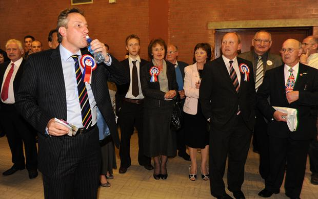Ian Paisley Jr celebrates with DUP Party memebrs after taking the North Antrim seat at the election count in the Seven Towers Leisure Centre in Ballymena