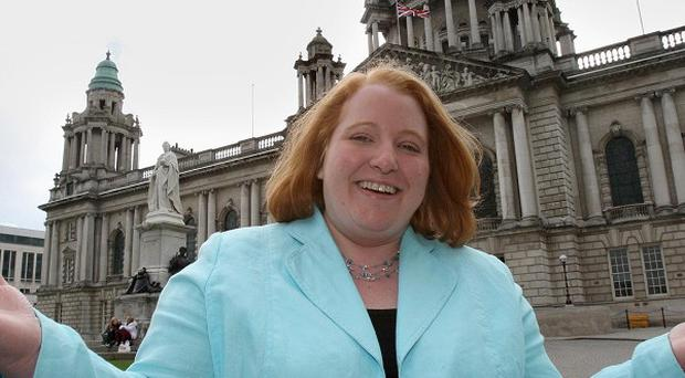 Naomi Long outside Belfast City Hall after her win over DUP leader Peter Robinson