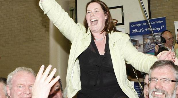 Sinn Fein MP Michelle Gildernew, party leader Gerry Adams (right) and Martin McGuinness MP celebrate her victory