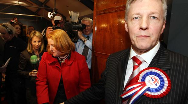 The DUP's Peter Robinson congratulates Alliance Party's Naomi Long after her East Belfast election victory