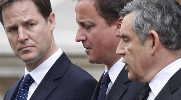 Nick Clegg, left, is preparing for further discussions with David Cameron (centre) and has also talked to Gordon Brown