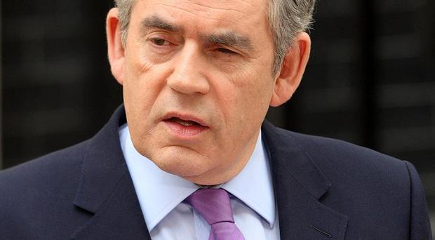 Gordon Brown delivers a statement to the media in Downing Street