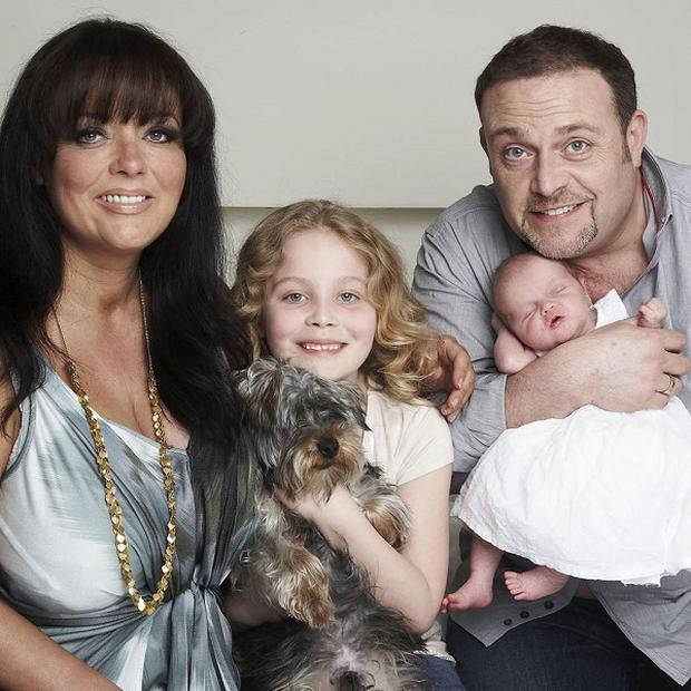 John Thomson and his wife Samantha with daughters Olivia, 7, and newborn Sophia Melody
