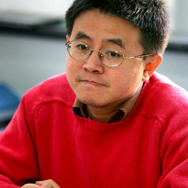 Wan Yanhai a prominent Chinese Aids activist has left China after he was increasingly harassed (AP)