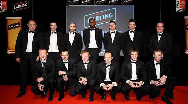 The Carling Team of the Season lined up at the Europa Hotel to receive their awards. Pictured are (back row, l-r): Gerry Armstrong, Billy Joe Burns (Linfield), Colin Coates (Crusaders), Alvin Rouse (Dungannon Swifts), Kevin Braniff (Portadown), Rory Patterson (Coleraine) and Niall McMullan (Carling). Front row (l-r) David Magowan (Crusaders), Neil McCafferty (Dungannon Swifts), George McMullan (Cliftonville), Ronan Scannell (Cliftonville), Jamie Mulgrew (Linfield), and Darren Boyce (Coleraine)