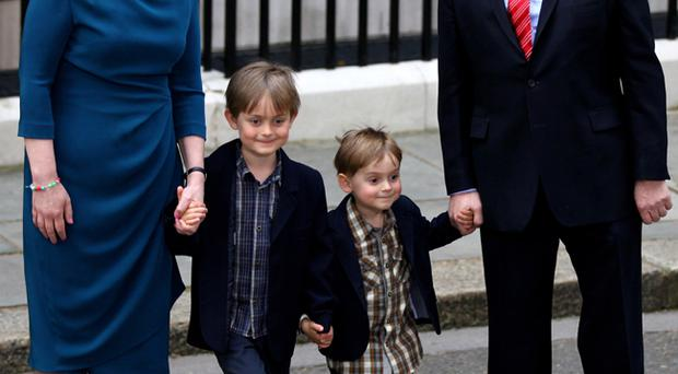 Prime Minister Gordon Brown, his wife Sarah and their sons James Fraser and John leave Downing Street on May 11, 2010 in London, England. After five days of negotiation a Conservative and Liberal Democrat coalition government has been confirmed
