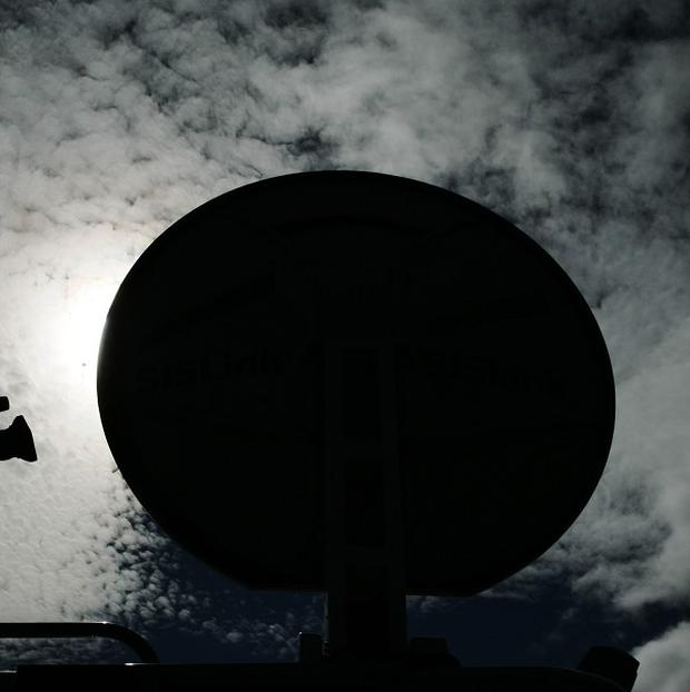 A TV satellite is drifting out of control above Earth