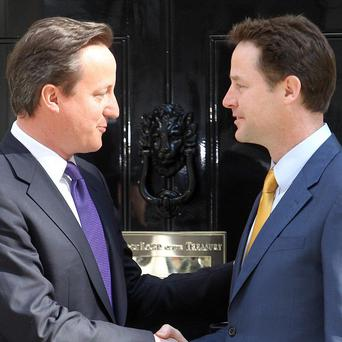 New Prime Minister David Cameron (left) with the new Deputy Prime Minister Nick Clegg
