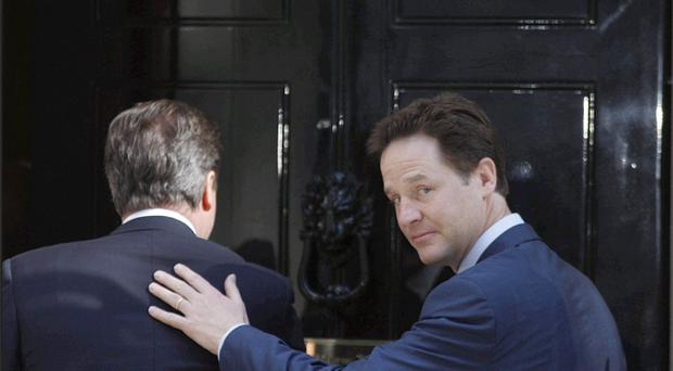 Prime Minister David Cameron (left) with Deputy Prime Minister Nick Clegg on the steps of 10 Downing Street in central London