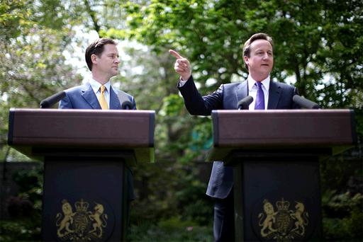 Prime Minister David Cameron (right) and Deputy Prime Minister Nick Clegg hold their first joint press conference in the Downing Street garden on May 12, 2010 in London