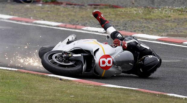 Lucky escape: Guy Martin takes a tumble during today's NW 200 practice