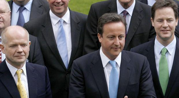 David Cameron insists the coalition government will defy the doubters
