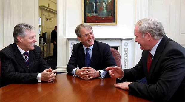 Secretary of State Owen Paterson (centre) meets First Minister Peter Robinson (left) and his deputy Martin McGuinness