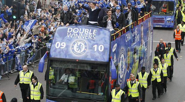 Crowds of supporters watched captain John Terry and his Chelsea team-mates celebrate on an open-deck bus through west London