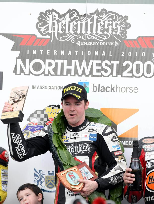 Alaster Seeley celebrates his win at the North West 200