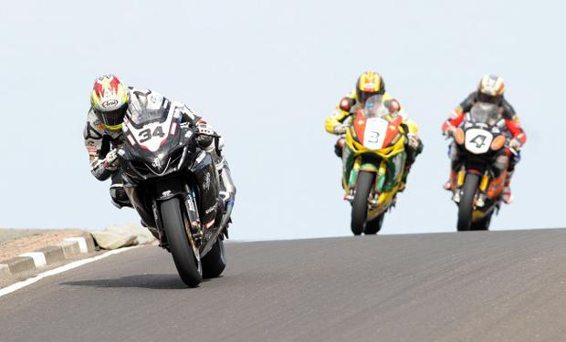 Alaister Seeley leads Stuart Easton and John McGuinness over Blacks Hill during todays North West 200 International races in Northern Ireland. 15/5/2010
