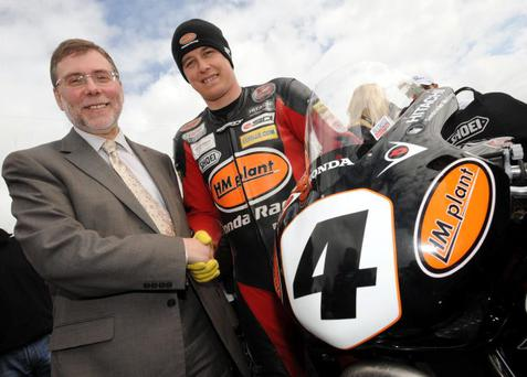 Sports Minister Nelson McCausland chats with pole place man John McGuinness of HM Plant Honda before the start of racing at the North West 200 today. 15/5/2010