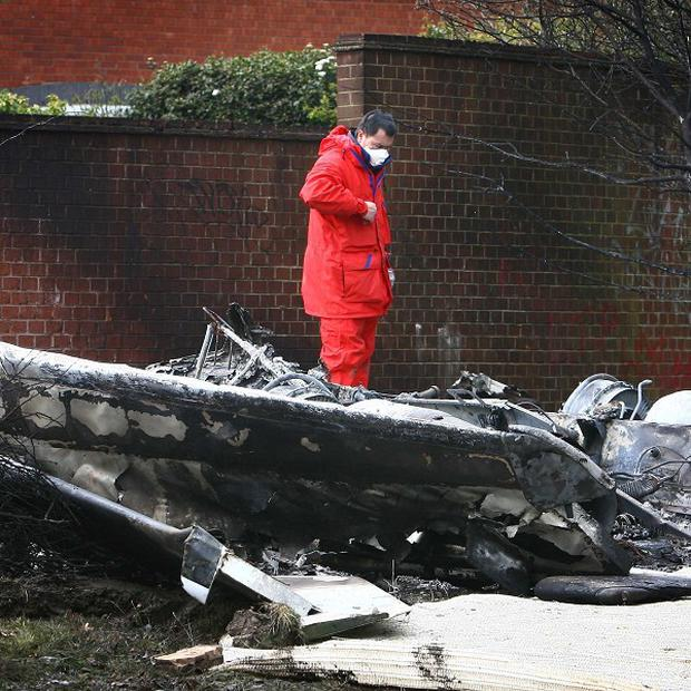 An air accidents investigator surveys the scene of an air crash in Romsey Close, Farnborough, Kent