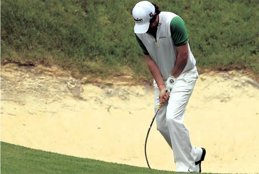 Breaking point: Rory McIlroy shows his frustration after failing to hit out of a greenside bunker on the 10th hole