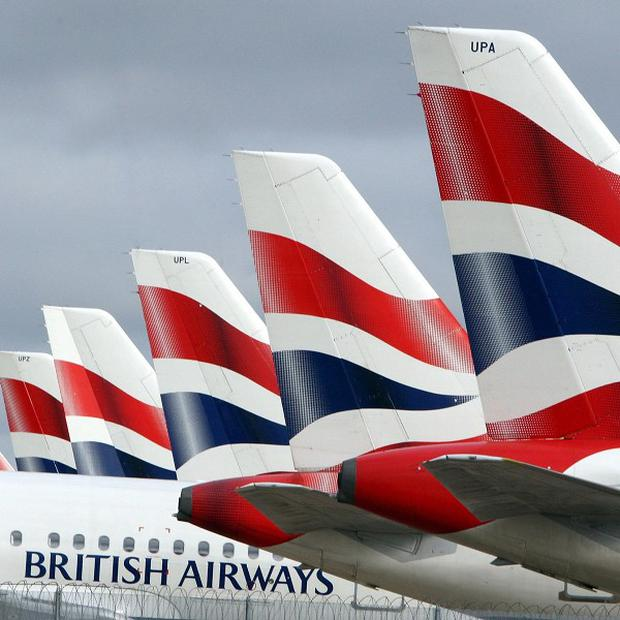 Beleaguered British Airways has posted record annual losses of £531 million
