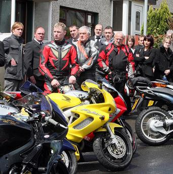 Mourners gather at the funeral of Mark Young, who was killed in a bike accident at last year's North West 200