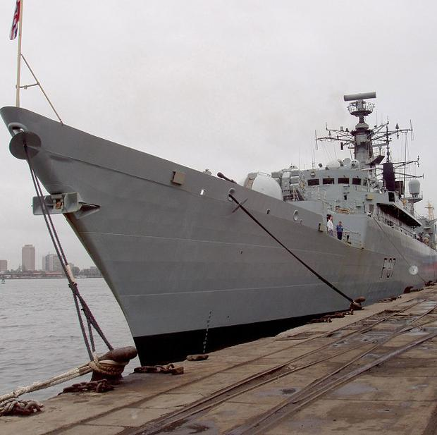 HMS Chatham rescued the crew of a merchant vessel from a tropical cyclone off Somalia