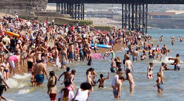 Brighton beach in East Sussex was busy with visitors enjoying the sun