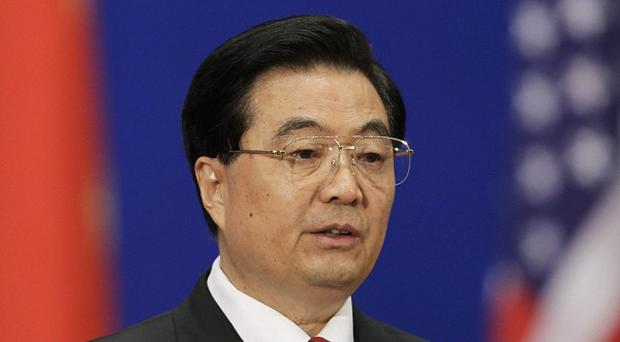 China's president Hu Jintao has promised more reforms to its controversial exchange rate controls (AP)