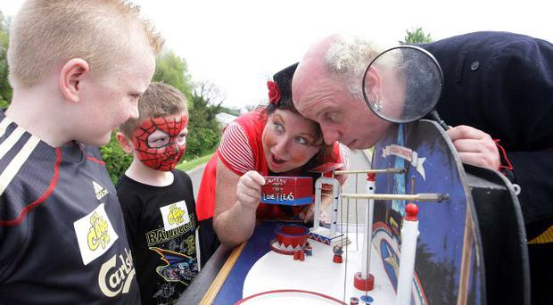22nd May 2010. Children's festival in the Waterworks in north Belfast. Left to right. Sean McDermott(8) with his brother Sean are entertained at the Flea Circus by Madame Tiptop and Felix Flip-flop.