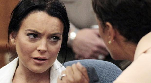 Lindsay Lohan talks to her lawyer during a court hearing in Beverly Hills (AP)