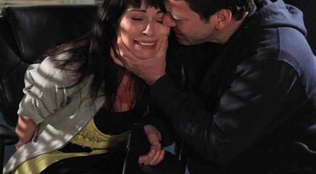 Tony Gordon, played by Gray O'Brian, with Carla Conner, played by Alison King, during the siege at the Underworld lingerie factory