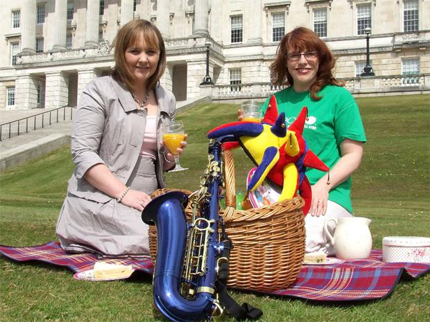DUP MLA Michelle McIlveen and NSPCC community fundraising manager Karen Walker jazz up the private lawns of Stormont Estate to prepare for the NSPCC June Jamboree this Father's Day