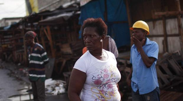 People look at soldiers on patrol in Kingston, Jamaica (AP)