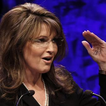 Sarah Palin said she would build a fence around her home to keep her neighbour from peering in (AP)