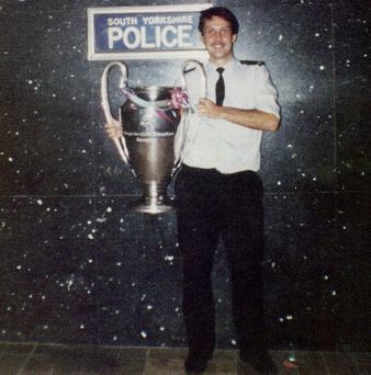 PC Mick Greenhough holding the European Cup