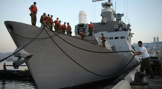 Israeli Navy sailors embark on a warship in order to stop a flotilla of activists attempting to deliver aid to Gaza in spite of Israel's blockade May 30, 2010 in Haifa, Israel