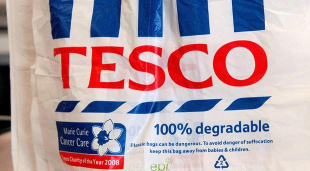 Tesco has announced it will pay workers a record bonus