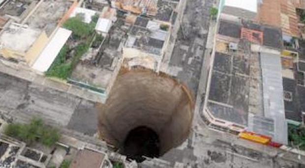 Sinkholes around the world - A sinkhole covers a street intersection in downtown Guatemala City