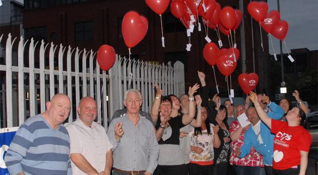 Sarah Beacom in the red T-shirt pays tribute to her late father Billy with a fundraising night for Chest Heart and Stroke
