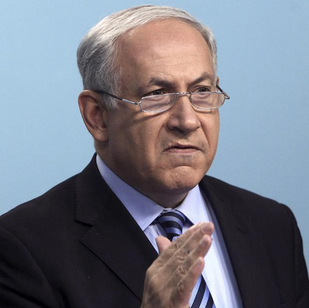 Israeli PM Benjamin Netanyahu has rejected calls for an international probe into the Gaza flotilla raid (AP)