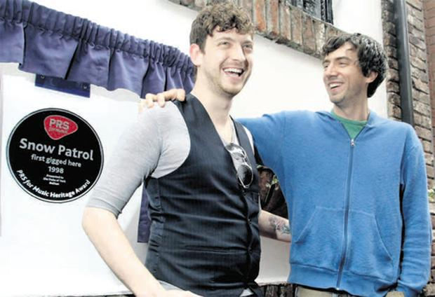 Snow Patrol's Nathan Connolly and Gary Lightbody outside the Duke Of York where a special plaque was unveiled to celebrate their gig in the Belfast pub in 1998