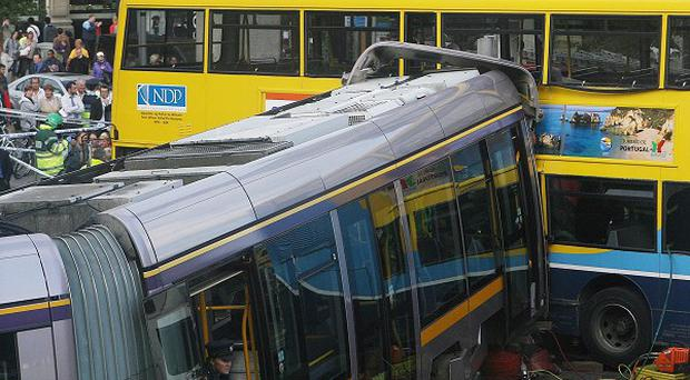 A tram driver has been charged over a collision with a double decker bus at the corner of Abbey Street and O'Connell Street in Dublin