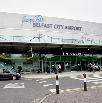 A low-flying aircraft dislodged roof tiles near George Best Belfast City Airport