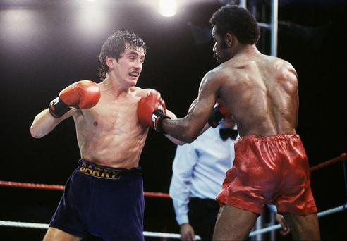 Barry McGuigan drives forward against Eusebio Pedroza at Loftus Road in 1985